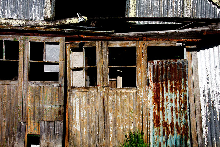 Dilapidated doors to an abandoned garage and filling station 2012