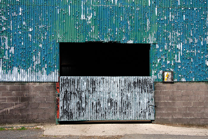 A cowshed in blockwork and peeling paint on corrugated iron 2015