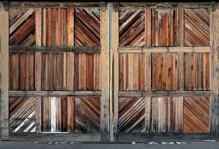 Large rail-mounted timber doors to a quayside building in San Francisco 2008